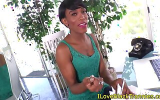 Shorthaired ebony trans tugging her big dong